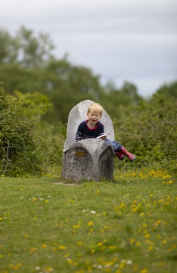 Toddler enjoying play at RSPB Conwy Nature Reserve
